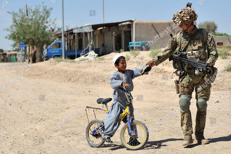 Runner up picture - Lance Corporal Nathan Williams from the One Royal Welsh Regiment on foot patrol in Afghanistan.