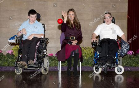 Catherine Duchess of Cambridge taking part in a throwing the ball exercise with Richard Armstrong (blue shirt) and Michael Bell (white shirt) from Percy Hedley school, during a visit to the Newcastle Civic Centre