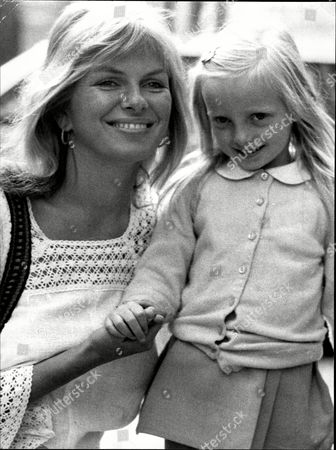 Actress And Model Julie Ege With 4yo Daughter Joanna Julie Ege (12 November 1943 A 29 April 2008) Was A Norwegian Actress And Model. Ege Was Born In Hayland Sandnes; She Was A Miss Norway And Miss Universe Contestant And A Penthouse Pet. In 1967 She Moved To England As An Au Pair To Improve Her English And Also Studied At A Language School. She Made Her Film Debut In A Low Budget Norwegian Film Stompa Til Sjas (jennings At Sea). Ege Appeared In 1969's On Her Majesty's Secret Service As Helen The 'scandinavian Girl.' She Later Starred In Hammer Film Productions' Creatures The World Forgot And The Legend Of The 7 Golden Vampires. Other Appearances Include The Gluttony Segment Of The Magnificent Seven Deadly Sins. She's Probably Best Remembered For Her Role In The 1971 Comedy Hit Film 'up Pompeii' Alongside Frankie Howerd. She Played 'voluptua' A Roman Ruler. Her Voice However Was Overdubbed By Another Actress For The Film. Her Famous Punchline Being When Told 'it's Nice' Replies Slowly ' Yes I Know I've Tried It'. In A Uk Tv Documentary A Few Years Before Her Death She Stated That She Never Minded Being Labelled A Glamour Actress And That It Had Been A Good Life Which Basically Helped Pay The Bills. Ege Was Married And Divorced Twice And Had Two Daughters. She Lived In Oslo Where She Worked As A Nurse Until Her Death From Breast Cancer Aged 64. She Had Previously Been Treated For Breast Cancer And Lung Cancer.
