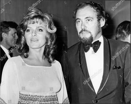 Actress And Model Julie Ege With Jimmy Sangster At Film Premiere Of 'santa Victoria' Julie Ege (12 November 1943 A 29 April 2008) Was A Norwegian Actress And Model. Ege Was Born In Hayland Sandnes; She Was A Miss Norway And Miss Universe Contestant And A Penthouse Pet. In 1967 She Moved To England As An Au Pair To Improve Her English And Also Studied At A Language School. She Made Her Film Debut In A Low Budget Norwegian Film Stompa Til Sjas (jennings At Sea). Ege Appeared In 1969's On Her Majesty's Secret Service As Helen The 'scandinavian Girl.' She Later Starred In Hammer Film Productions' Creatures The World Forgot And The Legend Of The 7 Golden Vampires. Other Appearances Include The Gluttony Segment Of The Magnificent Seven Deadly Sins. She's Probably Best Remembered For Her Role In The 1971 Comedy Hit Film 'up Pompeii' Alongside Frankie Howerd. She Played 'voluptua' A Roman Ruler. Her Voice However Was Overdubbed By Another Actress For The Film. Her Famous Punchline Being When Told 'it's Nice' Replies Slowly ' Yes I Know I've Tried It'. In A Uk Tv Documentary A Few Years Before Her Death She Stated That She Never Minded Being Labelled A Glamour Actress And That It Had Been A Good Life Which Basically Helped Pay The Bills. Ege Was Married And Divorced Twice And Had Two Daughters. She Lived In Oslo Where She Worked As A Nurse Until Her Death From Breast Cancer Aged 64. She Had Previously Been Treated For Breast Cancer And Lung Cancer.