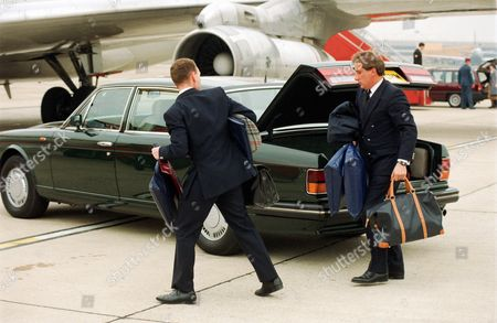 Royal aides unloading luggage from car