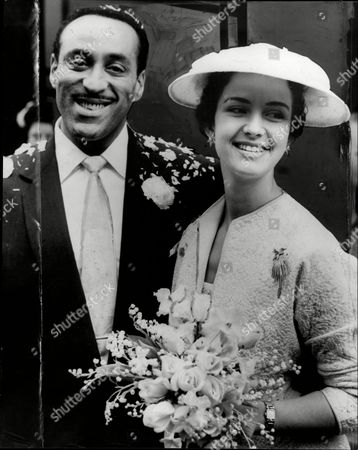 Singer And Bandleader Ray Ellington And Wife Actress Anita West (ann Wuest) At Their Wedding Henry Pitts Brown (17 March 1915 A 27 February 1985) Known Professionally As Ray Ellington Was A Popular English Singer Drummer And Bandleader. He Is Best Known For His Appearances On The Goon Show From 1951 To 1960. The Ray Ellington Quartet Had A Regular Musical Segment On The Show And Ellington Also Had A Small Speaking Role In Many Episodes Often As A Parodic African Native American Or Arab Chieftain (but Also Often With No Attempt To Change His Normal Accent As A Female Secretary Or A Scotsman). He Was Married To Anita West Who Was To Become The Second Female Presenter Of Blue Peter When She Replaced Leila Williams But She Only Lasted A Few Weeks In This Role. They Had Two Small Children (lance And Nina) When The Marriage Ended In Divorce Due To Ellington's Constant Touring. Ellington's Recording Of 'the Madison' Reached #36 In The Uk Singles Chart In November 1962. Ray's Son Lance Ellington Is A Singer Who Has Recorded Several Jazz Oriented Albums And Is One Of The Backing Singers In The Bbc Show Strictly Come Dancing. Lance Ellington Also Appeared In Tributes To Peter Sellers And In The Film The Life And Death Of Peter Sellers Where He Played His Father. Ray Ellington Died Of Cancer On 27 February 1985.