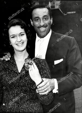 Singer And Bandleader Ray Ellington And Fiancee Later To Be His Wife Actress Anita West (ann Wuest) At Their Engagement Henry Pitts Brown (17 March 1915 A 27 February 1985) Known Professionally As Ray Ellington Was A Popular English Singer Drummer And Bandleader. He Is Best Known For His Appearances On The Goon Show From 1951 To 1960. The Ray Ellington Quartet Had A Regular Musical Segment On The Show And Ellington Also Had A Small Speaking Role In Many Episodes Often As A Parodic African Native American Or Arab Chieftain (but Also Often With No Attempt To Change His Normal Accent As A Female Secretary Or A Scotsman). He Was Married To Anita West Who Was To Become The Second Female Presenter Of Blue Peter When She Replaced Leila Williams But She Only Lasted A Few Weeks In This Role. They Had Two Small Children (lance And Nina) When The Marriage Ended In Divorce Due To Ellington's Constant Touring. Ellington's Recording Of 'the Madison' Reached #36 In The Uk Singles Chart In November 1962. Ray's Son Lance Ellington Is A Singer Who Has Recorded Several Jazz Oriented Albums And Is One Of The Backing Singers In The Bbc Show Strictly Come Dancing. Lance Ellington Also Appeared In Tributes To Peter Sellers And In The Film The Life And Death Of Peter Sellers Where He Played His Father. Ray Ellington Died Of Cancer On 27 February 1985.