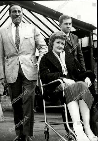 Singer And Bandleader Ray Ellington With His Singer Maureen Donne And His Guitarist Desmond Mcgovern Who Were All Injured In A Car Crash Henry Pitts Brown (17 March 1915 A 27 February 1985) Known Professionally As Ray Ellington Was A Popular English Singer Drummer And Bandleader. He Is Best Known For His Appearances On The Goon Show From 1951 To 1960. The Ray Ellington Quartet Had A Regular Musical Segment On The Show And Ellington Also Had A Small Speaking Role In Many Episodes Often As A Parodic African Native American Or Arab Chieftain (but Also Often With No Attempt To Change His Normal Accent As A Female Secretary Or A Scotsman). He Was Married To Anita West (ann Wuest) Who Was To Become The Second Female Presenter Of Blue Peter When She Replaced Leila Williams But She Only Lasted A Few Weeks In This Role. They Had Two Small Children (lance And Nina) When The Marriage Ended In Divorce Due To Ellington's Constant Touring. Ellington's Recording Of 'the Madison' Reached #36 In The Uk Singles Chart In November 1962. Ray's Son Lance Ellington Is A Singer Who Has Recorded Several Jazz Oriented Albums And Is One Of The Backing Singers In The Bbc Show Strictly Come Dancing. Lance Ellington Also Appeared In Tributes To Peter Sellers And In The Film The Life And Death Of Peter Sellers Where He Played His Father. Ray Ellington Died Of Cancer On 27 February 1985.