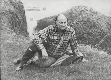 Iain Cuthbertson Relaxes On The Island Of Staffa.
