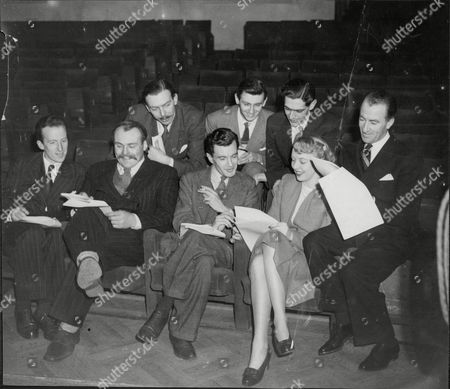 Stock Image of Actor And Comedian Dick Bentley During Recording Of Radio Show 'take It From Here' The Cast L-r Frank Muir Alan Dean Denis Norden Front Row L-r Wallas Eaton Jimmy Edwards Charles Maxwell Joy Nichols And Dick Bentley Charles Walter 'dick' Bentley (14 May 1907 A 27 August 1995) Born In Melbourne Australia Was A Comedian And Actor. He Starred With Jimmy Edwards In Take It From Here For Bbc Radio. As A Boy Bentley Learned Several Musical Instruments And While Still In His Teens Was A Staple On The Melbourne Cabaret Circuit As A Comedian And Singer His Act Consisting Of Playing A Few Bars Of Music Deliberately Badly Interspersed With Jokes And Legitimate Musical Numbers. He Made His First Appearance On Abc Radio In The Early 1930s And By 1938 Had Become A Fairly Prominent Personality Notably On Wilfrid Thomas's Show 'out Of The Bag'. In That Year He Moved To London And Worked For The Bbc. Newly Married To Peta He Returned To Australia On The Outbreak Of War And Spent Several Years Entertaining The Troops In The Pacific Theatre.