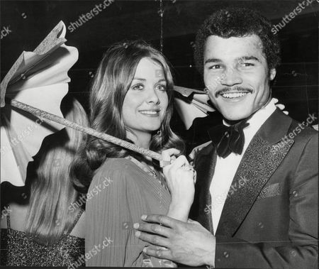 Light-heavyweight Boxing Champion Boxer John Conteh Dancing With Helen Morgan After She Was Crowned Miss World John Conteh (born 27 May 1951 In Kirkby Liverpool England) Is A British Former Boxer Who Was World Light-heavyweight Boxing Champion. Conteh Is One Of Britain's Most Successful Boxing Champions. He Enjoyed Great Fame In Britain And Was Often On The Front As Well As The Back Pages Of The Leading Dailies Due To His Love Of Partying And Women. Conteh Said That His Excessive Lifestyle Brought About A Premature Decline In His Talents. He Started Boxing At Age 10 At The Kirkby Club That Was A Training Ground For Some Of The Best Amateur Boxers Joey Singleton Tucker Hethering And Stuart Morton Were Only A Few. At 19 He Won The Middleweight Gold Medal At The 1970 British Commonwealth Games. He Won The Wbc Light Heavyweight Crown In October 1974 By Defeating Jorge Ahumada And Held The Title Until 1977 When He Was Stripped For Not Going Through With A Mandated Defense.[1] He Was The Loser In A Fifteen Round Split Decision To The Yugoslavian Fighter Mate Parlov In An Attempt To Regain The Title. He Failed Twice In Further Efforts To Win Back His Old Crown In 1979 And Then Again Seven Months Later In 1980 - Both Against The American Matthew Saad Muhammad. Muhammad Won Both Bouts But His First Victory Was Declared Void Because His Cornermen Used An Illegal Substance On A Cut. He Retired From Professional Boxing In 1980. His Professional Record Is 34 Wins 1 Draw And 4 Losses. In 1973 Conteh Was One Of The Celebrities Featured Dressed In Prison Gear On The Cover Of The Wings Album Band On The Run. Conteh Also Has The Distinction Of Being British Superstars Competition Champion In 1974 The Second Year Of The Televised Sporting Event. Conteh Is Now An After-dinner Speaker And Speaks At Venues All Across The Country. Conteh Appeared On The B.
