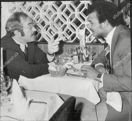 Light-heavyweight Boxing Champion Boxer John Conteh (r) With Boxing Commentator Reg Gutteridge At Lunch John Conteh (born 27 May 1951 In Kirkby Liverpool England) Is A British Former Boxer Who Was World Light-heavyweight Boxing Champion. Conteh Is One Of Britain's Most Successful Boxing Champions. He Enjoyed Great Fame In Britain And Was Often On The Front As Well As The Back Pages Of The Leading Dailies Due To His Love Of Partying And Women. Conteh Said That His Excessive Lifestyle Brought About A Premature Decline In His Talents. He Started Boxing At Age 10 At The Kirkby Club That Was A Training Ground For Some Of The Best Amateur Boxers Joey Singleton Tucker Hethering And Stuart Morton Were Only A Few. At 19 He Won The Middleweight Gold Medal At The 1970 British Commonwealth Games. He Won The Wbc Light Heavyweight Crown In October 1974 By Defeating Jorge Ahumada And Held The Title Until 1977 When He Was Stripped For Not Going Through With A Mandated Defense.[1] He Was The Loser In A Fifteen Round Split Decision To The Yugoslavian Fighter Mate Parlov In An Attempt To Regain The Title. He Failed Twice In Further Efforts To Win Back His Old Crown In 1979 And Then Again Seven Months Later In 1980 - Both Against The American Matthew Saad Muhammad. Muhammad Won Both Bouts But His First Victory Was Declared Void Because His Cornermen Used An Illegal Substance On A Cut. He Retired From Professional Boxing In 1980. His Professional Record Is 34 Wins 1 Draw And 4 Losses. In 1973 Conteh Was One Of The Celebrities Featured Dressed In Prison Gear On The Cover Of The Wings Album Band On The Run. Conteh Also Has The Distinction Of Being British Superstars Competition Champion In 1974 The Second Year Of The Televised Sporting Event. Conteh Is Now An After-dinner Speaker And Speaks At Venues All Across The Country. Conteh Appeared On The Bbc Tele.