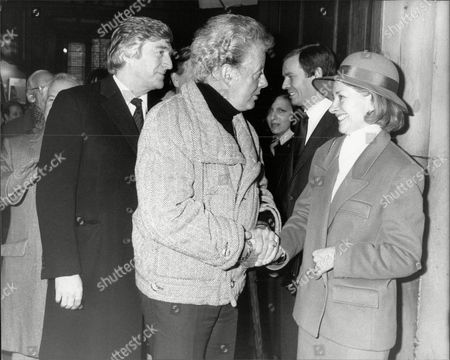 Stock Photo of Danny La Rue And Michael Parkinson Speak To Gwyneth Henderson The Widow Of Dickie Henderson As They Leave The Memorial Service For Him.