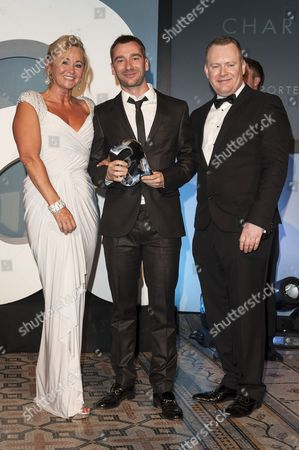 Stock Photo of Amanda Wills and Matthew Todd present Charlie Condou with Man Of The Year Award