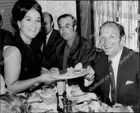 Boxer Henry Cooper Marks His Retirement With Lunch Served By Wife Albina At Her Uncle's Restaurant. Boxing Correspondent Reg Gutteridge Is On The Left. (cooper Died 5/11).