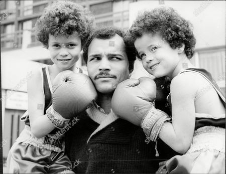 Light-heavyweight Boxing Champion Boxer John Conteh With Boxing Nephews Robert And Scott Sons Of Robert Conteh John Conteh (born 27 May 1951 In Kirkby Liverpool England) Is A British Former Boxer Who Was World Light-heavyweight Boxing Champion. Conteh Is One Of Britain's Most Successful Boxing Champions. He Enjoyed Great Fame In Britain And Was Often On The Front As Well As The Back Pages Of The Leading Dailies Due To His Love Of Partying And Women. Conteh Said That His Excessive Lifestyle Brought About A Premature Decline In His Talents. He Started Boxing At Age 10 At The Kirkby Club That Was A Training Ground For Some Of The Best Amateur Boxers Joey Singleton Tucker Hethering And Stuart Morton Were Only A Few. At 19 He Won The Middleweight Gold Medal At The 1970 British Commonwealth Games. He Won The Wbc Light Heavyweight Crown In October 1974 By Defeating Jorge Ahumada And Held The Title Until 1977 When He Was Stripped For Not Going Through With A Mandated Defense.[1] He Was The Loser In A Fifteen Round Split Decision To The Yugoslavian Fighter Mate Parlov In An Attempt To Regain The Title. He Failed Twice In Further Efforts To Win Back His Old Crown In 1979 And Then Again Seven Months Later In 1980 - Both Against The American Matthew Saad Muhammad. Muhammad Won Both Bouts But His First Victory Was Declared Void Because His Cornermen Used An Illegal Substance On A Cut. He Retired From Professional Boxing In 1980. His Professional Record Is 34 Wins 1 Draw And 4 Losses. In 1973 Conteh Was One Of The Celebrities Featured Dressed In Prison Gear On The Cover Of The Wings Album Band On The Run. Conteh Also Has The Distinction Of Being British Superstars Competition Champion In 1974 The Second Year Of The Televised Sporting Event. Conteh Is Now An After-dinner Speaker And Speaks At Venues All Across The Country. Conteh Appeared On The.