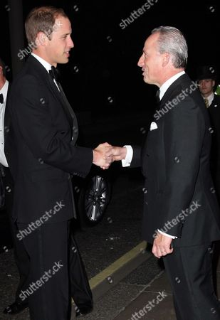 Prince William is welcomed by Kiaran MacDonald, General Manager of the Savoy hotel