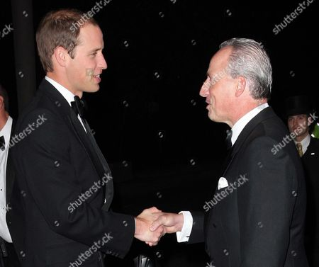 Stock Image of Prince William is welcomed by Kiaran MacDonald, General Manager of the Savoy hotel