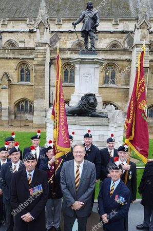 MP John Baron with Royal Regiment of Fusiliers veterans stand on parade next to the Oliver Cromwell statue