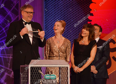 Stock Picture of (l-r) Collecting the Award for Best International Dagger Hans Rosenfeldt,(centre holding award ) the creator of the winning drama The Bridge with Sofia Helin (right)  and Ellen Hillingso (far right in front of Bradley Walsh )