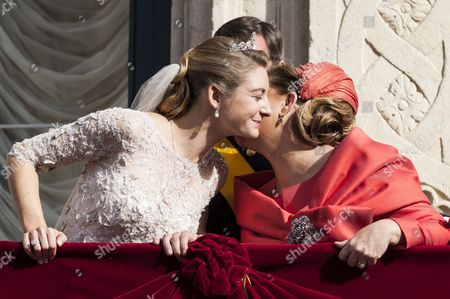 Countess Stephanie de Lannoy and Grand Duchess Maria Teresa of Luxembourg on the balcony