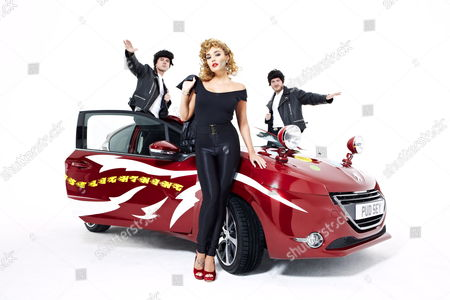 Stock Image of Tamara Ecclestone dressed as Sandy from Grease with Matt Littler and Darren Jeffries as T-Birds and a Greased Lightning Peugeot 208