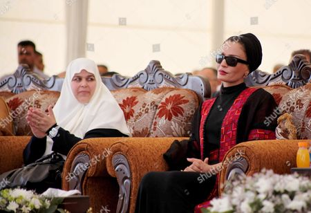 Qatar's First Lady Sheikha Mozah Bint Nasser Al Missned sits with the wife of Gaza's Prime Minister Ismail Haniyeh