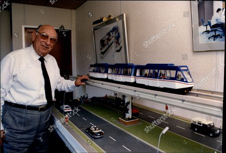 Stock Picture of Helicopter Millionaire Alan Bristow With A Model Of The Bryway Transit.