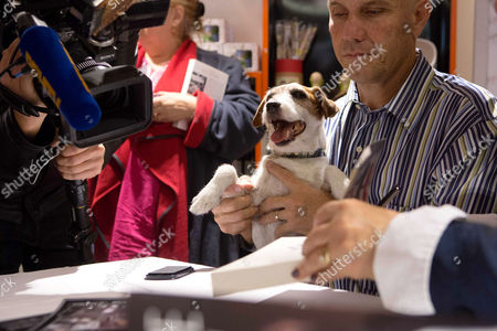 """Famous dog """" Uggie """", with his owner Omar von Muller"""