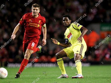Samuel Eto'o of Anzhi Makhachkala and Steven Gerrard of Liverpool