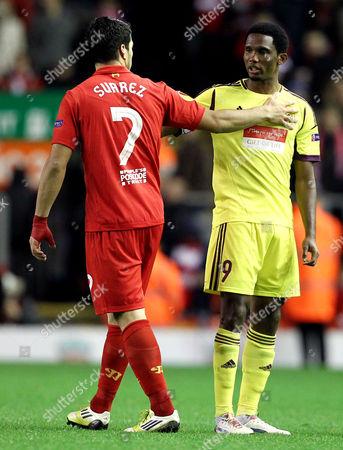 Luis Suarez of Liverpool with Samuel Eto'o of Anzhi Makhachkala