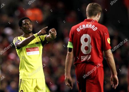 Samuel Eto'o of Anzhi Makhachkala behind Steven Gerrard of Liverpool