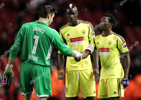 Samuel Eto'o of Anzhi Makhachkala shakes hands with Liverpool goalkeeper Brad Jones at the end of the game