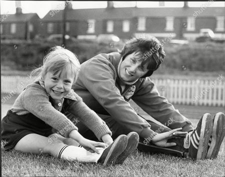 Athlete Runner Dorothy Hyman Training With 6yo Karen Harford At The Dorothy Hyman Stadium Dorothy Hyman (born 9 May 1941 In Cudworth Barnsley Yorkshire) Is A British Athlete Who Competed Mainly In The 100 Metres. She Competed For Great Britain In The 1960 Summer Olympics Held In Rome Italy In The 100 Metres Where She Won The Silver Medal. She Followed This Up By Winning The Bronze Medal In The 200 Metres. Four Years Later In Tokyo Japan In The 1964 Games She Helped The Great Britain Team Pick Up A Bronze Medal In The 4 X 100 M Relay With Team Mates Janet Simpson Mary Rand And Daphne Arden. She Also Won Individual 100 M Gold And 200 M Silver At The 1962 European Championships In Belgrade And Representing England Completed The 100 M/200 M Sprint Double At The 1962 Commonwealth Games. Arguably Britain's Best Ever Female Sprinter She Has A Stadium In Her Home Village In Cudworth Barnsley Named In Her Honour. In 2011 She Was Inducted Into The England Athletics Hall Of Fame.