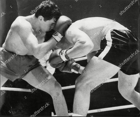 Stock Photo of Terry Downes Fights Fellow Boxer Mike Pusateri Manchester 1963.