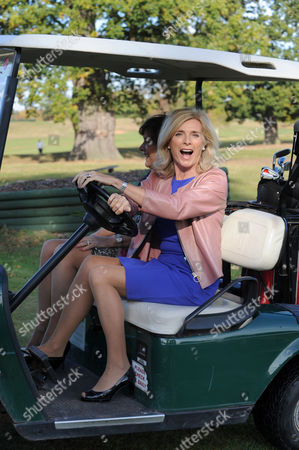 English actress Jan Harvey driving a golf buggy at Patshull Park Hotel in Staffordshire UK
