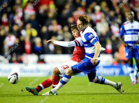 Andrei Arshavin of Arsenal in action with Kaspars Gorkss of Reading