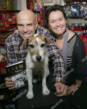Editorial image of Uggie the dog 'The Artist: My Story' book paw printing at WHSmith, Newbury, Britain - 31 Oct 2012