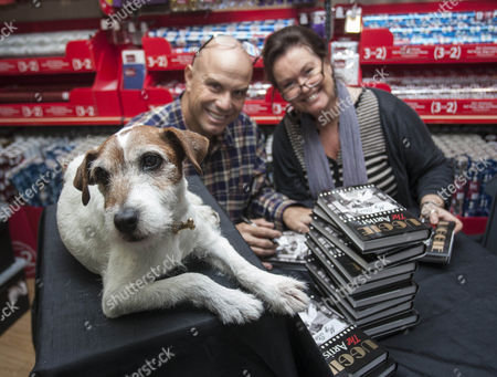 Uggie the dog, his trainer Omar von Muller   and The author of the book Wendy Holden