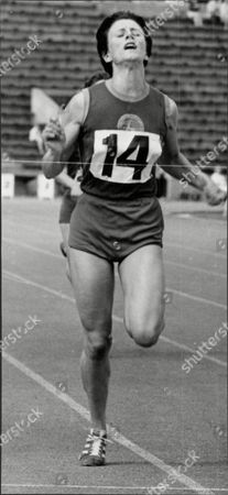 Athlete Runner Dorothy Hyman In Action Dorothy Hyman (born 9 May 1941 In Cudworth Barnsley Yorkshire) Is A British Athlete Who Competed Mainly In The 100 Metres. She Competed For Great Britain In The 1960 Summer Olympics Held In Rome Italy In The 100 Metres Where She Won The Silver Medal. She Followed This Up By Winning The Bronze Medal In The 200 Metres. Four Years Later In Tokyo Japan In The 1964 Games She Helped The Great Britain Team Pick Up A Bronze Medal In The 4 X 100 M Relay With Team Mates Janet Simpson Mary Rand And Daphne Arden. She Also Won Individual 100 M Gold And 200 M Silver At The 1962 European Championships In Belgrade And Representing England Completed The 100 M/200 M Sprint Double At The 1962 Commonwealth Games. Arguably Britain's Best Ever Female Sprinter She Has A Stadium In Her Home Village In Cudworth Barnsley Named In Her Honour. In 2011 She Was Inducted Into The England Athletics Hall Of Fame.