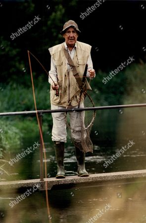 Editorial photo of Sir Michael Hordern Actor Fishing By River 1994.