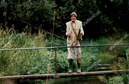 Stock Picture of Sir Michael Hordern Actor Fishing By River 1994.