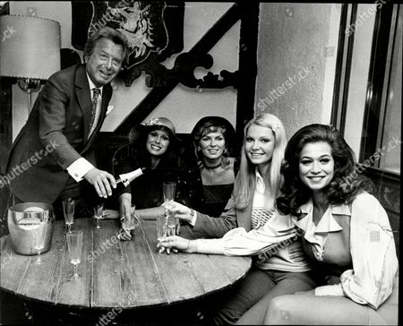 Impresario Lord Bernard Delfont With L-r Actress Joanna Lumley Julie Ege Former Miss World Eva Reuber-staier And Valerie Leon At Stoves Bar Bernard Delfont Baron Delfont (5 September 1909 A 28 July 1994) Born Boris (or Boruch) Winogradsky Was A Leading Russian-born British Theatrical Impresario. He Was Born In Tokmak Russian Empire The Second Son Of Isaac And Olga Winogradsky. His Brothers Lew Grade And Leslie Grade Also Entered Showbusiness. His Nephew Michael Grade (now Lord Grade Of Yarmouth) Leslie's Son Has Had A Long Career In Television. Delfont Entered Theatrical Management In 1941 After A Career As First A Dancer Then An Agent. He Presented Over 200 Shows In London And New York Including More Than 50 Musicals Such As The Original Productions Of Little Me Stop The World - I Want To Get Off City Of Angels And Sweet Charity. He Also Presented Summer Variety Shows In Many Towns Across The Country Mainly Seaside Resorts. As Chief Executive Of Emi Delfont Withdrew Funding For The Film Life Of Brian In 1978 At The Last Moment Due To Worries Over The Religious Implications; It Was Then Financed By George Harrison's Company Handmade Films And A Reference Is Made Jokingly To 'bernie' In The Last Line Of The Film During The Song 'always Look On The Bright Side Of Life'. He Converted The London Hippodrome Into The Talk Of The Town Nightclub Bringing In Entertainers Such As Shirley Bassey Frank Sinatra Eartha Kitt And Judy Garland And Also Securing The Exclusive Rights From Paul Derval To Stage The Folies Bergare For The First Time Outside Paris. He Married The Actress Carole Lynne In 1946.they Had One Son And Two Daughters. He Was Knighted In 1974 And Created A Life Peer As Baron Delfont Of Stepney In Greater London In 1976. He Died From A Heart Attack At His Angmering Home. Lord Delfont Was The Life President Of The Entertainment Artistes' Benevolent Fund While His Wife Served As Life Governor. His Widow Carole Lynne (lady Delfont) 89 Die.