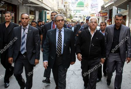 Egyptian politician and former Arab League Secretary-General, Amr Moussa walks around the old town market