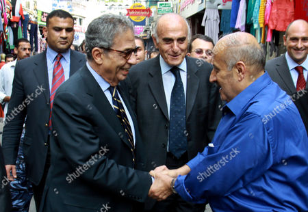 Egyptian politician and former Arab League Secretary-General, Amr Moussa meeting supporters as he walks around the old town market