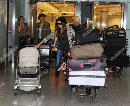 Frankie Sandford, and Una Healy pushing Baby Aoife Belle Foden and a trolley of luggage