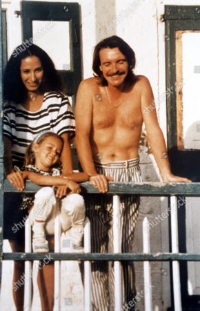 Ruth Kelly Secret Daughter of Eric Clapton, with Step Father Malcolm Kelly and Her Mother Yvonne Kelly at Their House, Pink Cottage on Island of Montserrat in West Indies