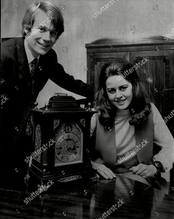Susan Bishop And James Maxwell With Antique Mantel Clock.