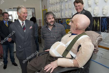 Prince Charles, Sir Peter Jackson and Peter Hambleton at the Weta Workshop in Wellington