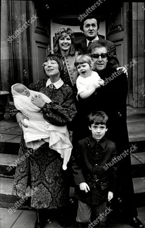Actor Peter Sellers Is The Godfather At Christening Of Julia Amanda Stark And Her Baby Brother Timothy Stark At St Paul's Covent Garden London Their Father Is Graham Stark One Of Peter's Best Friends The Other Godparent Is Family Friend Christina Krubrick (holding Baby Timothy) Also Pictured Is Graham Stark And Wife Audrey Stark At Back.