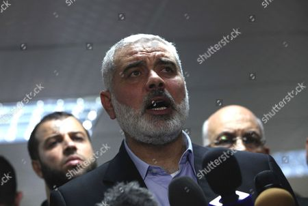 Palestinian Prime Minister in the Gaza Strip Ismail Haniyeh speaks during a press conference with Egyptian Prime Minister Hesham Qandil