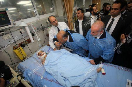 Saad al-Katatni visits the injured Palestinians at al-Shifa hospital