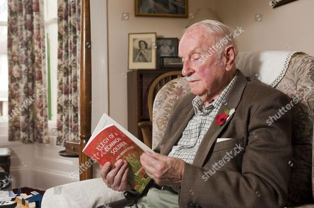 Dennis Wilson with his book of poems 'Elegy Of A Common Soldier'