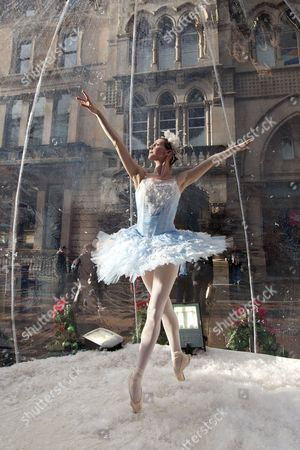 Claire Robertson from Scottish Ballet inside a giant snow globe, dressed as the Good Snow Flake